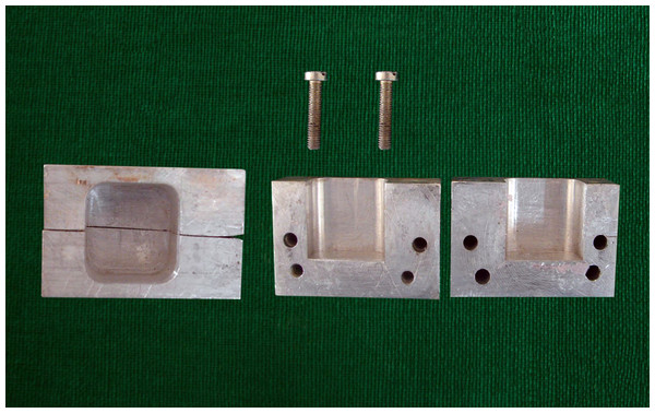 Photograph showing split mould for mounting samples.