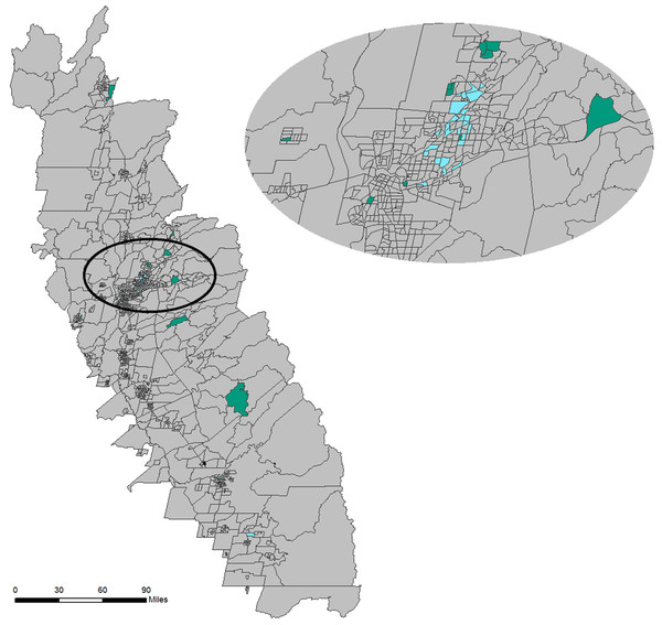 Geomap showing spatial context of census tracts contained in the cluster (#1 in the self-organizing map (SOM)) with the highest median age (green) and the census tracts in the cluster (#2 in the SOM) with the highest mosquito habitat risk (blue).